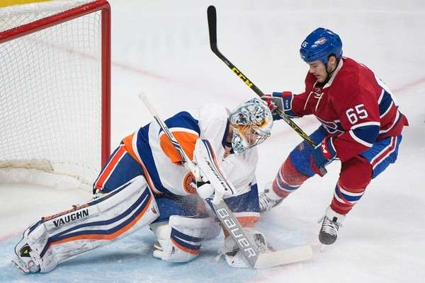 Montreal Canadiens' Andrew Shaw, left, moves in on