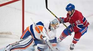 Montreal Canadiens' Andrew Shaw moves in on New