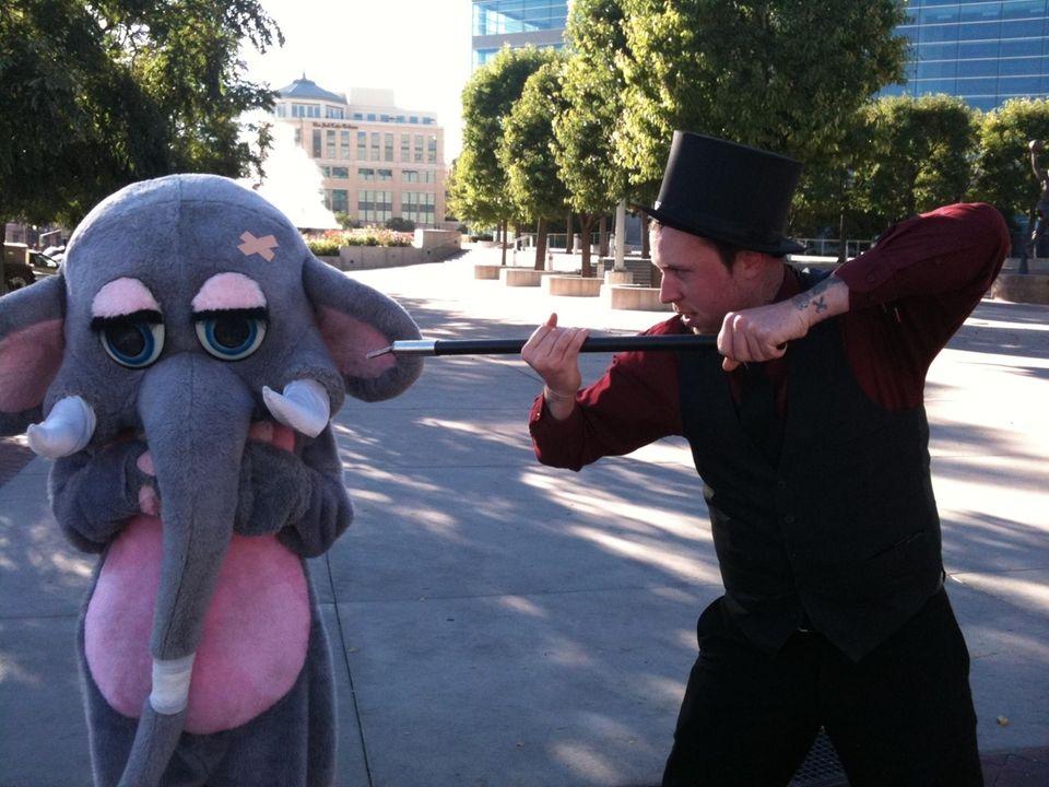 Local magician, Matt Bruce, and a teenage boy