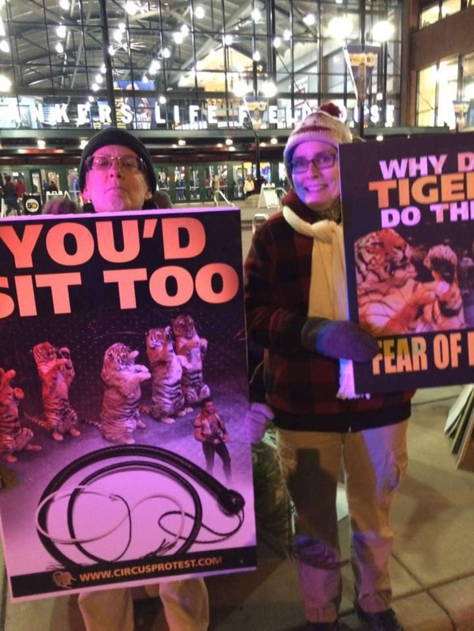 Delilah Williamson (L) and Mary Beth Collins protesting