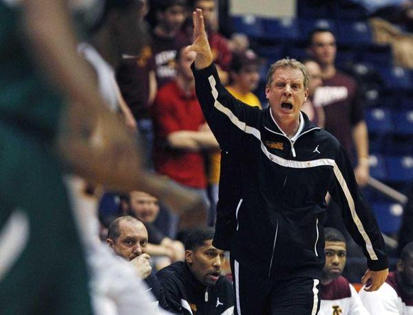 Iona head coach Tim Cluess calls to his
