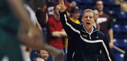 Iona head coach Tim Cluess calls to his