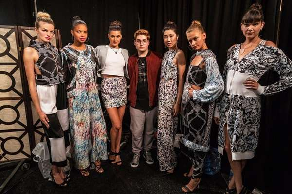 Chris Russo, 17, of Calverton, with models dressed