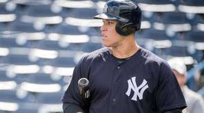New York Yankees' Aaron Judge looks on at