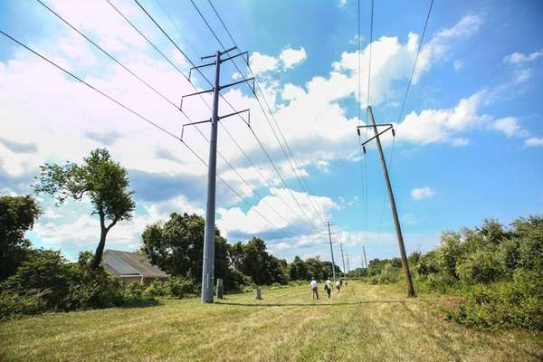Reporters walk along the Long Island Power Authority