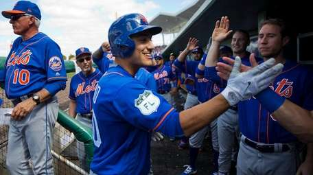 New York Mets outfielder Michael Conforto, center, high-fives