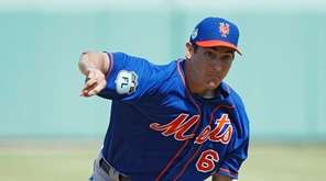 Seth Lugo of the New York Mets pitches