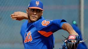 Mets righthander Marcos Molina throws during spring trainingl