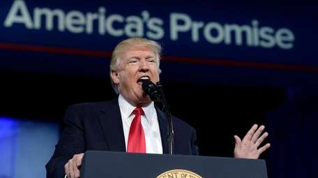 President Donald Trump speaks to a gathering Friday,