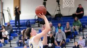 Mattituck's Corinne Reda (22) puts one up and