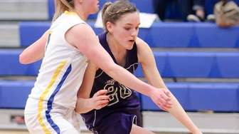 Port Jefferson's Courtney Lewis (20) drives to the
