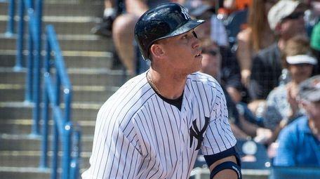 New York Yankees' Aaron Judge hitting a one