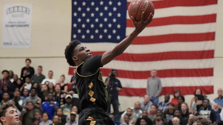 Wyandanch's Corey Stewart (5) with the layup during