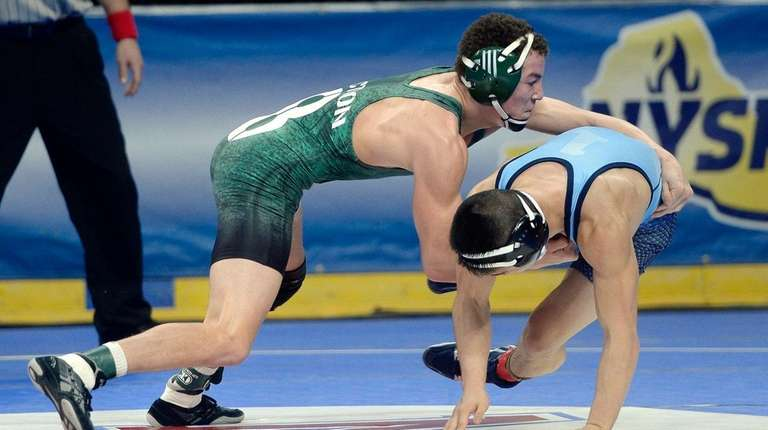 Locust Valley's Jonathan Gomez, left, wrestles against Putnam