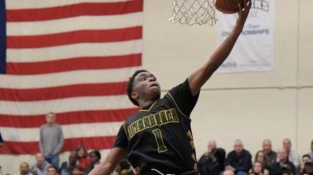 Wyandanch's Kashawn Charles, #1, puts up a layup