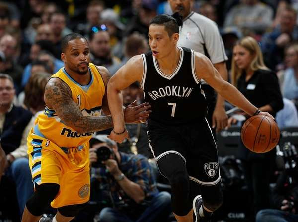 Nets guard Jeremy Lin, right, here working the