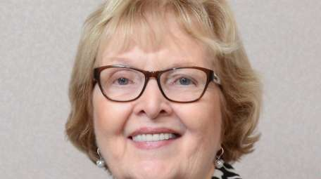 Peggy Nixdorf, of Central Islip, has been promoted