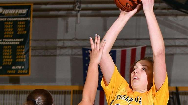 Gabriella Heimbauer #23 of Massapequa, right, shoots a