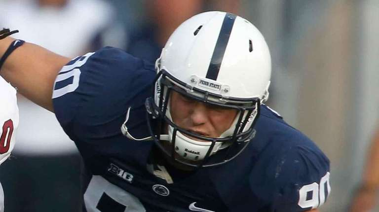 Penn State defensive end Garrett Sickels (90), right,