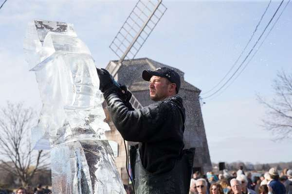 Hundreds of spectators watch an ice carving demonstration