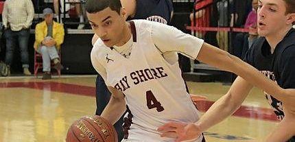 Bay Shore's Jose Rivera (4) drives to the