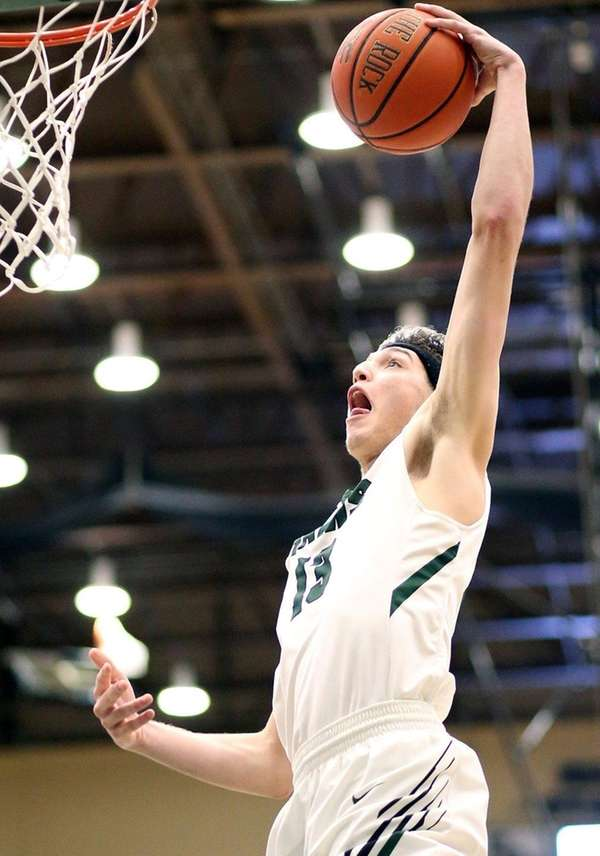 Farmingdale's George Riefenstahl slams for two during the