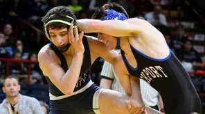 Half Hollow Hills West's Dylan Ryder, left, wrestles