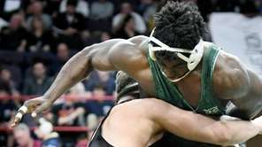 Uniondale's Zach Knighton-Ward, right, wrestles Canisius' Mason Hoose
