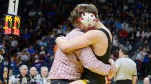 Wantagh's Justin Vines celebrates with his coach after