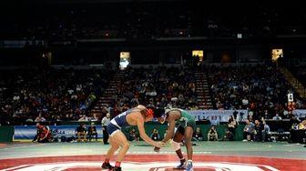 Long Beach's Jacori Teemer, right, wrestles Patchogue Medford's