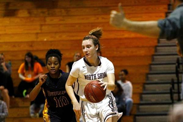 North Shore's Gabrielle Zaffiro, right, drives to the