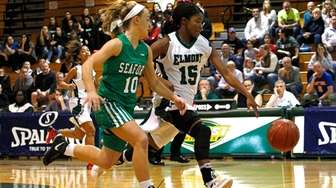 Zhaneia Thybulle of Elmont High School drives to