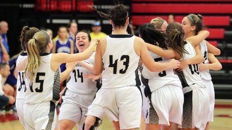 The Commack girls basketball team runs onto the
