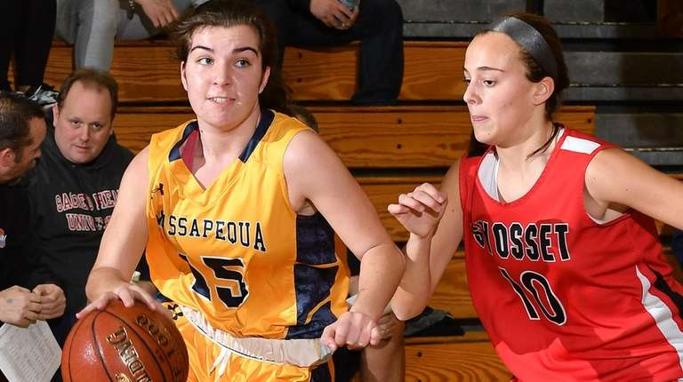 Helena Salmon #15 of Massapequa, left, gets pressured