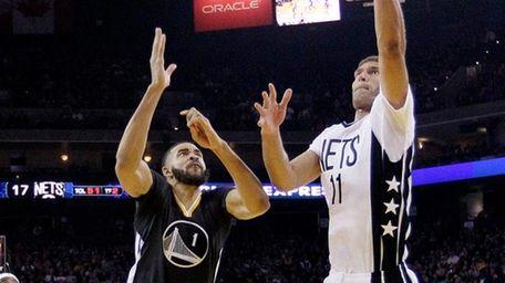 Brooklyn Nets' Brook Lopez (11) drives past Golden