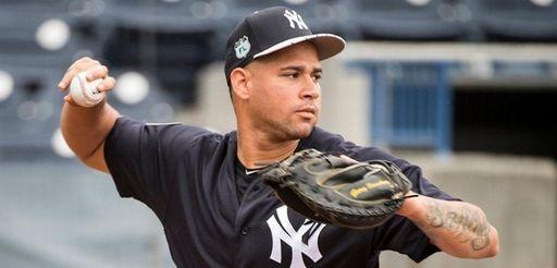 New York Yankeescatcher Gary Sanchez makes a throw