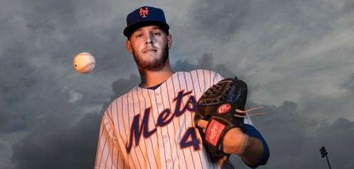 Mets pitcher Zack Wheeler poses during photo day