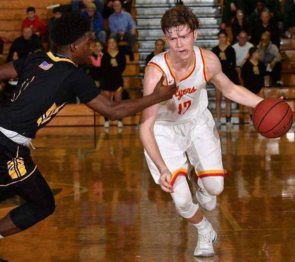 Kyle Murphy #12 of Chaminade, right, gets pressured