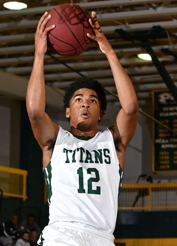 Camren Wynter of Holy Trinity drives to the