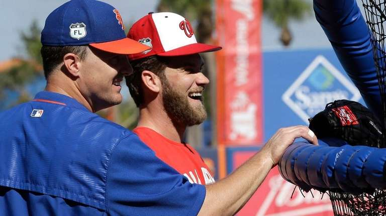 Washington Nationals' Bryce Harper laughs with New York