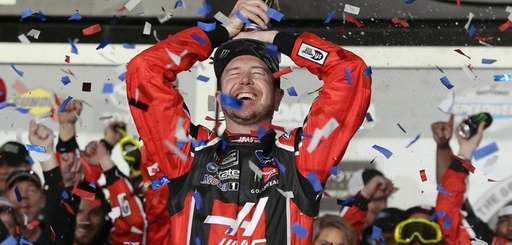 Kurt Busch celebrates in Victory Lane after winning