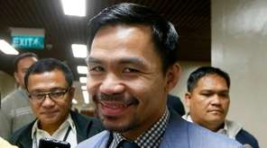 Filipino boxer and Sen. Manny Pacquiao talks to