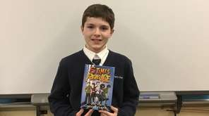 Kidsday reporter Michael Nawojchik with his copy of
