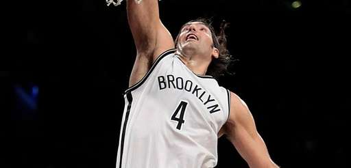 Brooklyn Nets forward Luis Scola finishes a fast