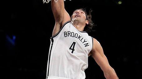 Brooklyn Nets forward Luis Scola finishes a fast