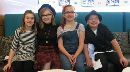 Actress Bebe Wood, with beret, with Kidsday reporters