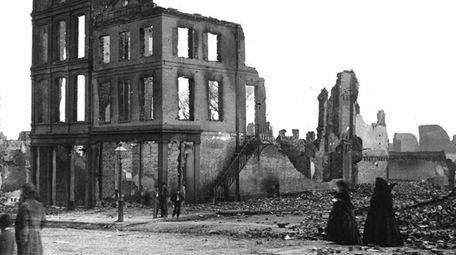 Residents walk through the ruins of Richmond, Virginia,