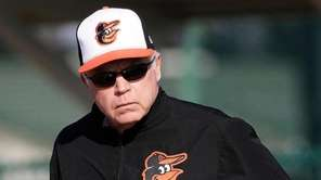 Baltimore Orioles manager Buck Showalter walks on the