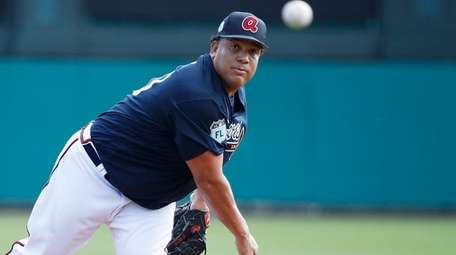 Bartolo Colon of the Braves pitches against the