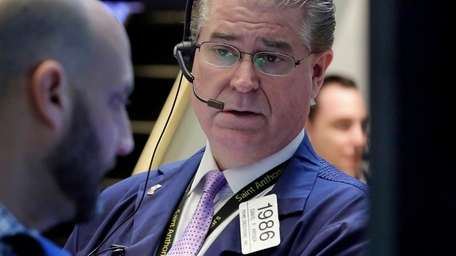 Trader Daniel Kryger works on the floor of